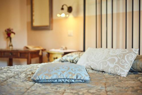 A bed or beds in a room at Agriturismo Palazzi Del Papa