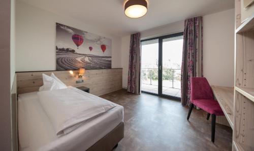 Ein Bett oder Betten in einem Zimmer der Unterkunft Motel 267