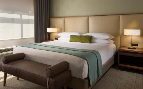 A bed or beds in a room at The Paramount Hotel