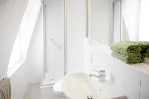 Ein Badezimmer in der Unterkunft Pension Villa Nordland