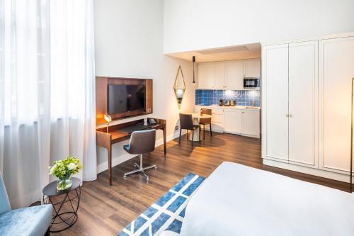 TV/Unterhaltungsangebot in der Unterkunft Fraser Suites Hamburg