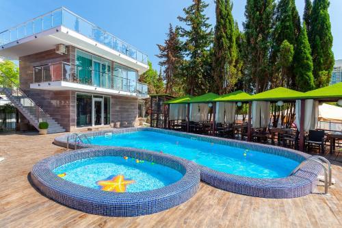 The swimming pool at or near Spa-Hotel Grace Arli
