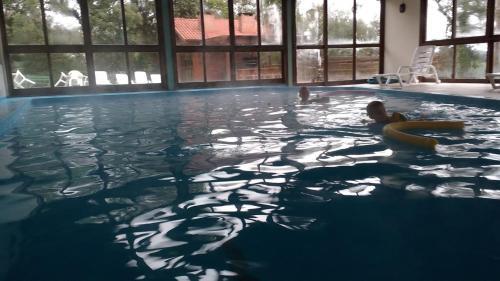 The swimming pool at or close to Residencial Pousada Serrano
