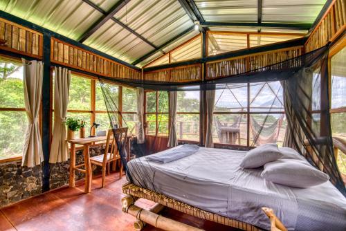 Un ou plusieurs lits dans un hébergement de l'établissement La Bambouseraie