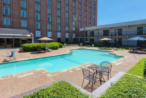 The swimming pool at or near MCM Elegante Hotel and Suites – Dallas