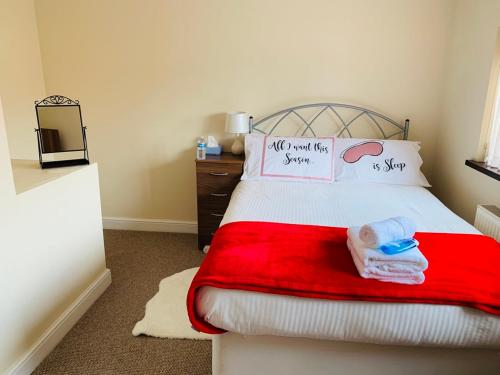 A bed or beds in a room at Housefield 1