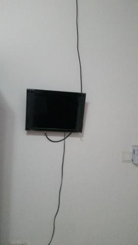 A television and/or entertainment center at MAC-P GUESTHOUSE