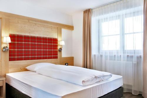 Ein Bett oder Betten in einem Zimmer der Unterkunft Garnì La Tranquillitè