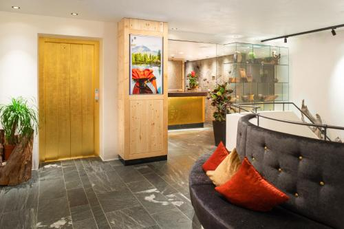 The lobby or reception area at Hotel Goldener Adler