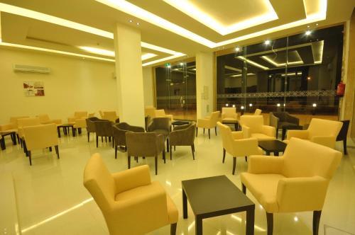 Um restaurante ou outro lugar para comer em ميرال الرس فرع الحزم