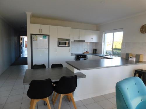 A kitchen or kitchenette at Merimbula Lake Apartments