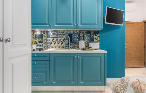 A kitchen or kitchenette at New!!! NEW RIVA LUXURY ONE - with sunny terrace & big garden