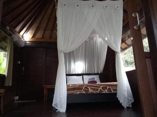 Ein Bett oder Betten in einem Zimmer der Unterkunft Mulia Home Stay