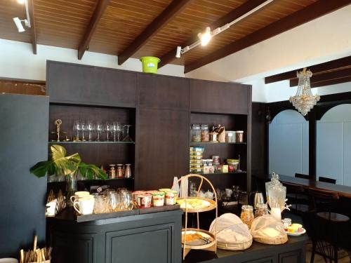 A restaurant or other place to eat at Siam Nitra Boutique Hotel