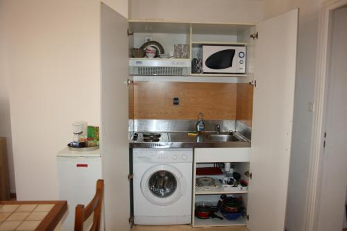 A kitchen or kitchenette at Residence St Sepulcre