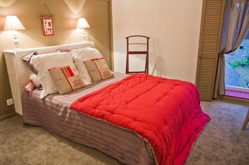 Un ou plusieurs lits dans un hébergement de l'établissement Le Cordon Blanc-Evran