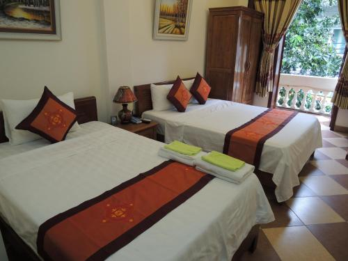 A bed or beds in a room at Hanoi Ecogreen Hostel