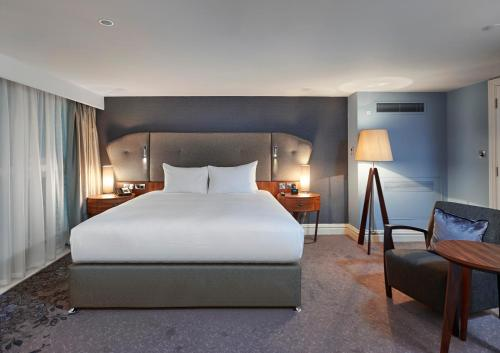 A bed or beds in a room at DoubleTree by Hilton Hotel & Spa Liverpool