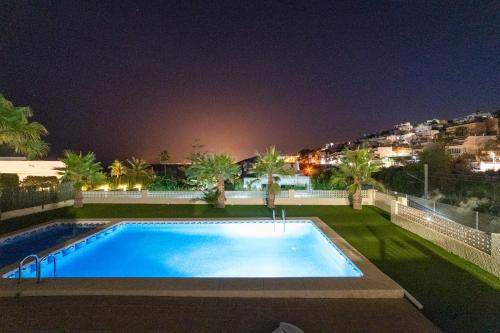 The swimming pool at or near Seanema Montiboli Suite Apartment