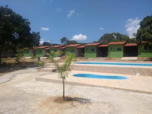 The swimming pool at or close to Recanto da Natureza Macaiba