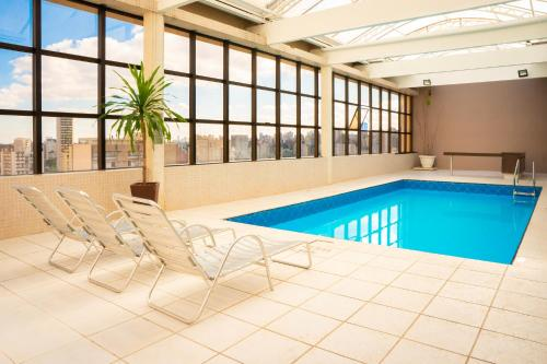 The swimming pool at or near Mercure Curitiba Golden