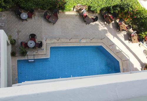 A view of the pool at New Farah Hotel or nearby