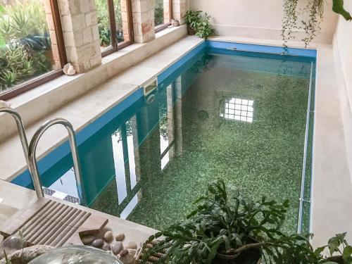 The swimming pool at or near Iconic Cretan Stone Mansion