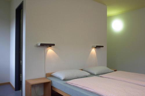 A bed or beds in a room at Zurich Youth Hostel