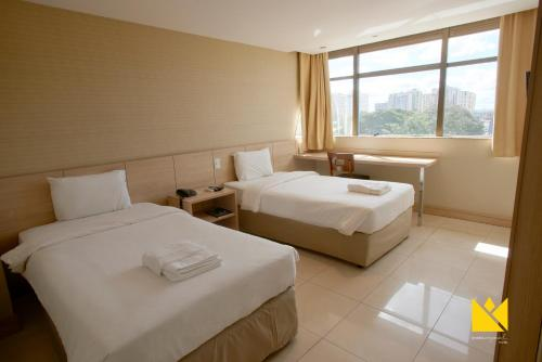 A bed or beds in a room at Brasília Imperial Hotel e Eventos