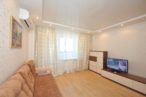 Телевизор и/или развлекательный центр в Апартаменты на Новороссийской