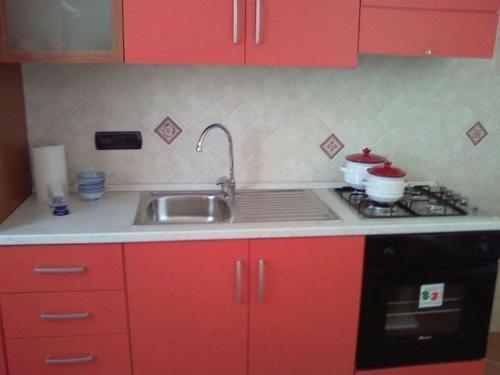 A kitchen or kitchenette at Appartamenti Sole Mare Agropoli