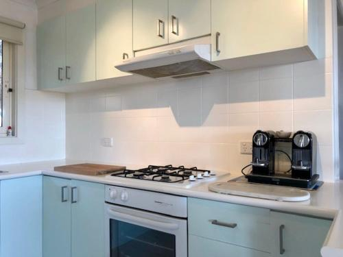 A kitchen or kitchenette at Sunsets in Blairgowrie