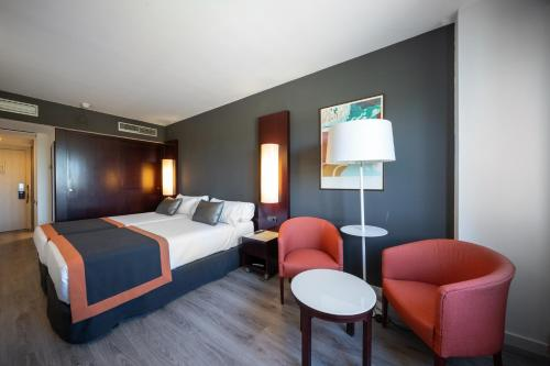 A bed or beds in a room at Catalonia Sabadell