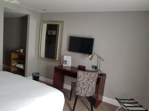 A television and/or entertainment center at Best Western Appleby Park Hotel