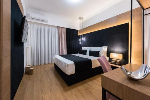 A bed or beds in a room at Acropolis View Deluxe Penthouse & Luxury Apartments