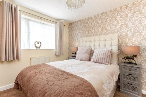 A bed or beds in a room at Beachcliffe Holiday Apartments