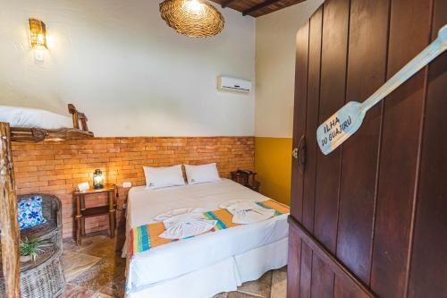 Cama ou camas em um quarto em Vila Parnaiba