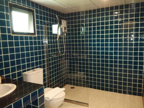 A bathroom at Scent of Sukhothai Resort