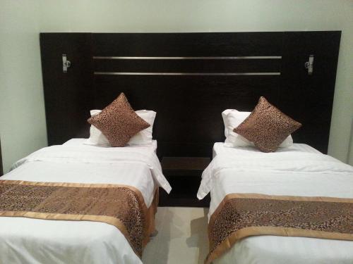 Cama ou camas em um quarto em Elaf Suits