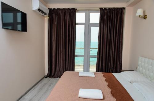Кровать или кровати в номере Отель Орхидея