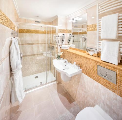 Ванная комната в Occidental Praha Wilson
