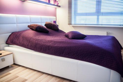 Łóżko lub łóżka w pokoju w obiekcie Platinum Towers Country 2 Country