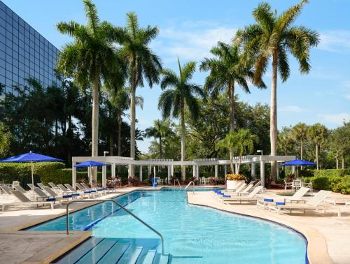 The swimming pool at or near Hilton Boca Raton Suites