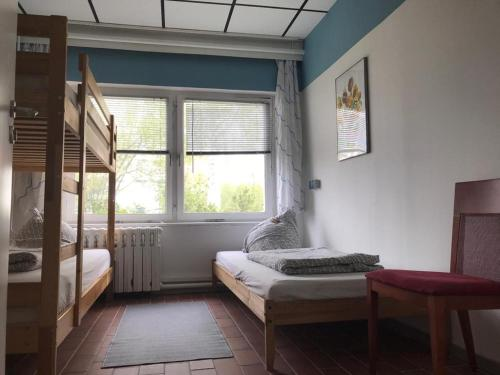 A bed or beds in a room at Backpackers Inn Rostock