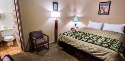 A bed or beds in a room at Goulding's Lodge