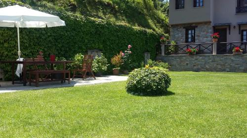 A garden outside Rinoula's Traditional Houses