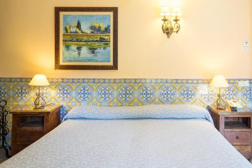 Cama o camas de una habitación en Hotel Rural Albamanjon