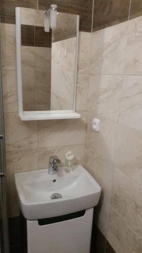 A bathroom at Apartma Moon by Jary