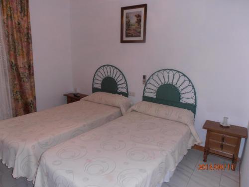 Cama o camas de una habitación en Hostal Restaurante Las Rejas