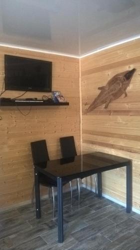 Телевизор и/или развлекательный центр в Bungalow Afrika